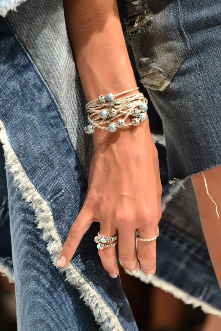 PALM SPRINGS, CA - APRIL 10: A model walks the runway wearing PANDORA Jewelry and Siwy Denim at the PANDORA Jewelry Experience #ArtofYou on April 10, 2015 in Palm Springs, California. (Photo by Araya Diaz/Getty Images for PANDORA Jewelry)